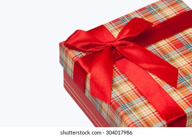 A beautiful red gift box with red bow.
