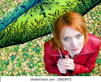 beautiful red girl in leather jacket with umbrella