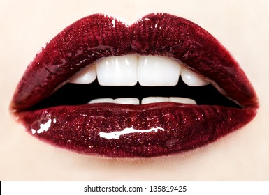 Beautiful red glossy lips close-up, macro photography