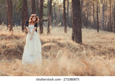 Beautiful Red Hair bride outdoors in a forest