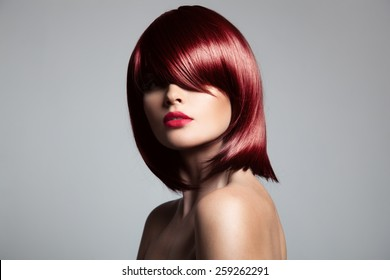 Beautiful red hair model with perfect glossy hair. Close-up portrait.