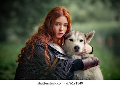 Beautiful red haired girl in metal medieval armor dress with swords sitting with dog and looking at camera. Fairy tale story about warrior  . Glowing light. Warm art work.