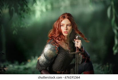 Beautiful red haired girl in metal medieval armor dress with swords sitting in warlike pose near river and looking afar. Fairy tale story about warrior . Glowing light. Warm art work.