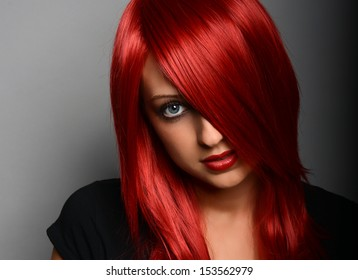 Beautiful red haired girl over gray background