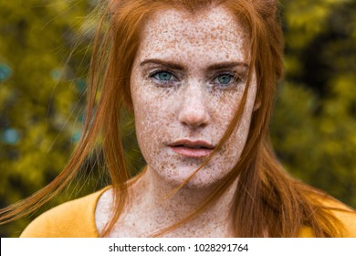 Beautiful red haired irish girl with blu eyes, red hair and lots of freckles
