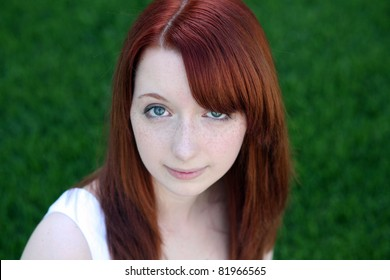 Beautiful Red Haired Teen Girl With Freckles In Grass