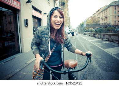 beautiful red head womanon bike in the city