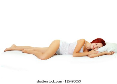 beautiful red head young woman sleeping over white background