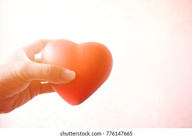 Beautiful red heart in hand with light shinning on Valentine day