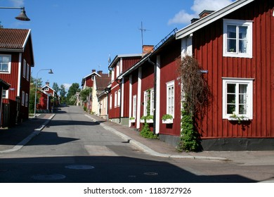 Beautiful red houses on a quiet street in Uppsala, Sweden