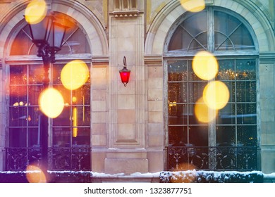 Beautiful red lantern with reflections on the building shot close-up