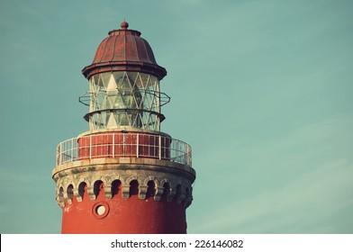 beautiful red Lighthouse Bovbjerg Fyr against blue skyin vintage style, Danish North Sea coast, Jutland, Denmark, Europe
