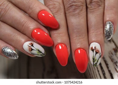 beautiful red manicure with a picture flowers on nails