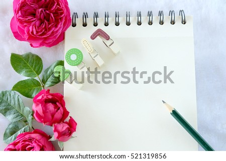 beautiful red rose flower with notepad on white fur backgroundhappy new year 2017