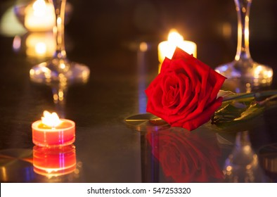 Beautiful red rose on a restaurant table.