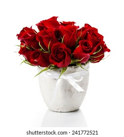 Beautiful red roses in a vase isolated on white