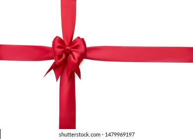 Beautiful red silk bow on a red ribbon tied with a cross isolated on white background