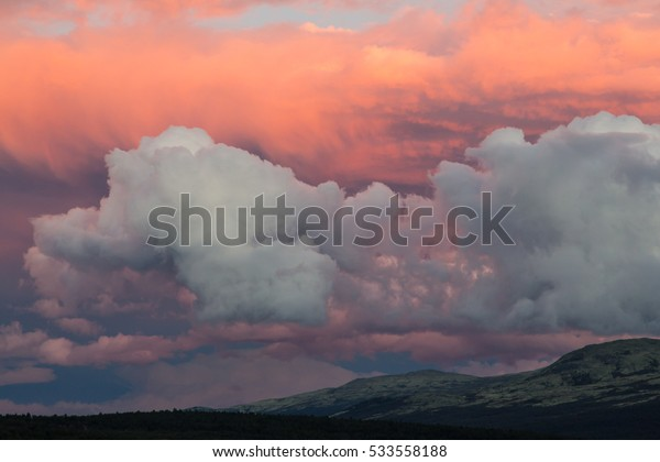 Beautiful red sky with clouds during sunset in the mountains
