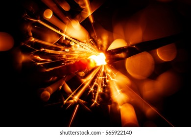 Beautiful red sparkler candle. Abstract close-up look.
