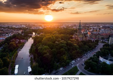 Beautiful red sunset in aerial view from Timisoara taken by a professional drone - Timi?oara Orthodox Cathedral, Bega and Central Park