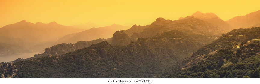 Beautiful red sunset in the mountains creating a mystical an subtle silhouette of the landscape