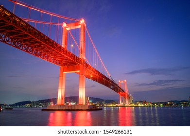 Beautiful red suspension bridge illuminated by the sunset