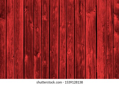 Beautiful red wood background made of old wooden boards.