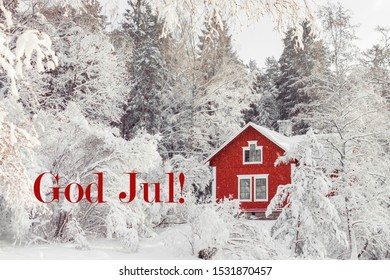 Beautiful red wooden house in snow fairy forest. Sweden. Winter scenery with red cottage surrounded by trees covered with snow and frost. Card with red text God Jul (Merry Christmas in Swedish).