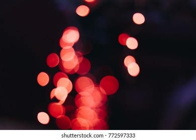 beautiful red xmas lights out of focus. ideal background for a christmas and new year card. enough room for copy, space and text.