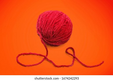 Beautiful red yarn clew on the desk