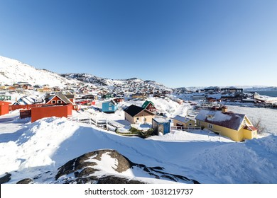 Beautiful red, yellow, blue and other colors nestled in the snow in Europe during the winter. In the clear sky on a good day in the winter.Qaqortoq Greenland