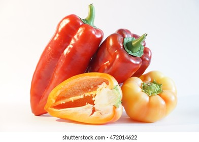 Beautiful red and yellow peppers isolated on white background