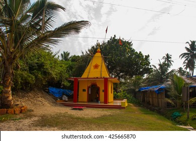 Beautiful red and yellow small temple on the beach. Goa. Arambol. India.
