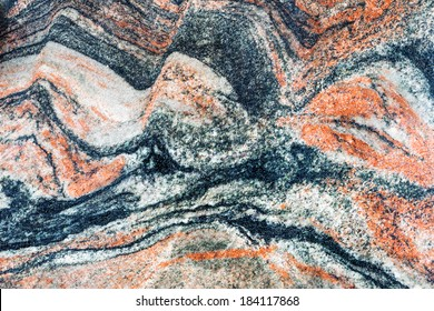 beautiful reddish-brown interior decorative stone marble abstract cracks and stains on the surface