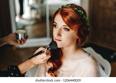 Beautiful red-haired bride makeup