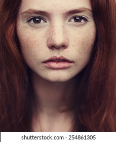 beautiful red-haired girl close-up
