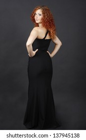 beautiful red-haired girl in a long black dress