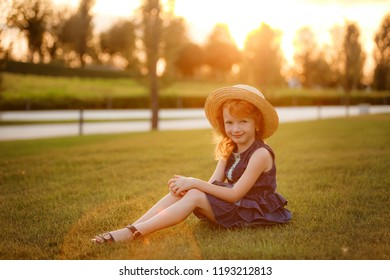 Beautiful red-haired girl in the park. sunset, autumn
