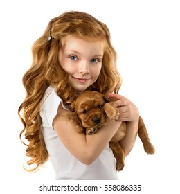Beautiful red-haired little girl with puppy isolated on white background. Space for Your Text. Fashion, style kid and pet friendship