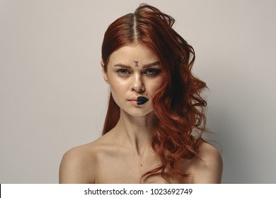 beautiful red-haired woman, zodiac signs, twins, horoscope