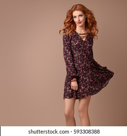 Beautiful Redhead Girl In Fashion Floral Dress Smiling. Young Playful Model  Woman, Wavy Curly