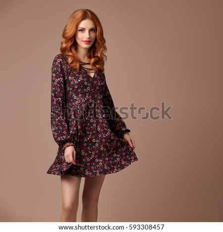 b88530299 Beautiful Redhead Girl in Fashion Floral Dress Smiling. Young Playful Model  Woman
