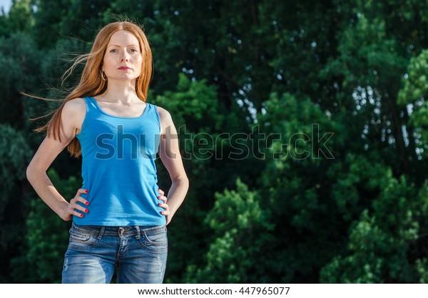 beautiful redhead girl or woman enjoy nature