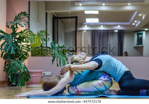 beautiful redhead girl or woman practicing yoga