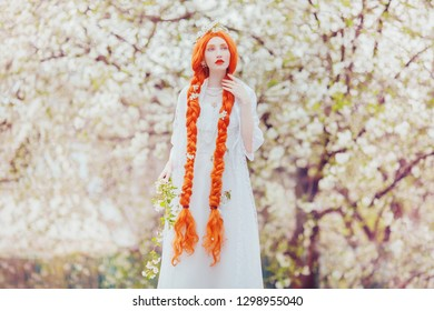 Beautiful redhead kawaii girl with plait on spring garden background. Woman in pastel dress in nature on sakura background. Spring flower in garden. Kawaii japan girl. Blossom sakura in park.