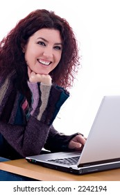 Beautiful redhead with laptop over white background.