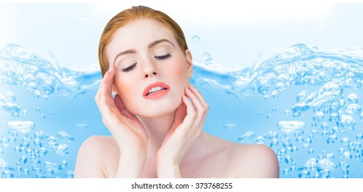 Beautiful redhead posing with hands against close up on blue sparkling water