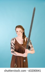 Beautiful redhead warrior girl in celtic tribal makeup