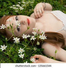 Beautiful Redhead With White Flowers