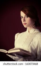 Beautiful redhead women with book